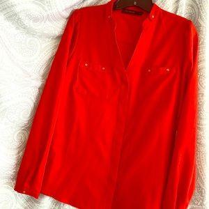 Bright Orangey-Red button down blouse.